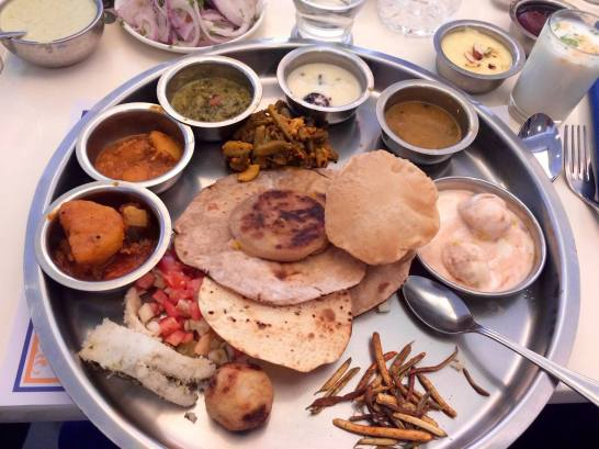 Thali, a platter of breads, rice, and gravies.