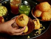 Pani Puri, Mumbai style. My favorite snack of all time. You get one at a time but six in total. One comes up before you can even put the thing in your mouth. It's fun to have the locals laugh at you when you first try this.